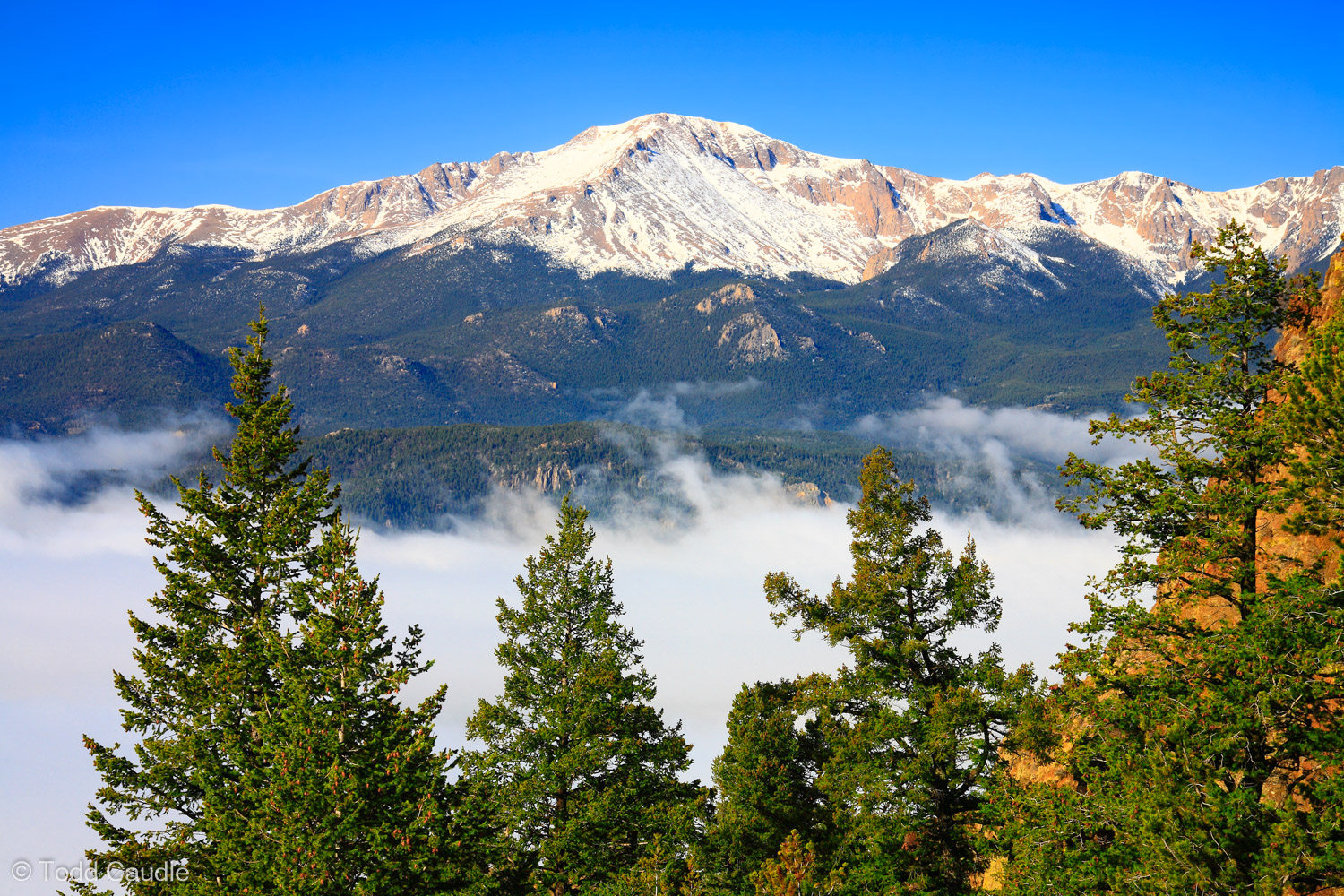 Pikes Peak defines the view from nearby Rampart Range. Rising from the Eastern Plains, weather systems sometimes push moist...