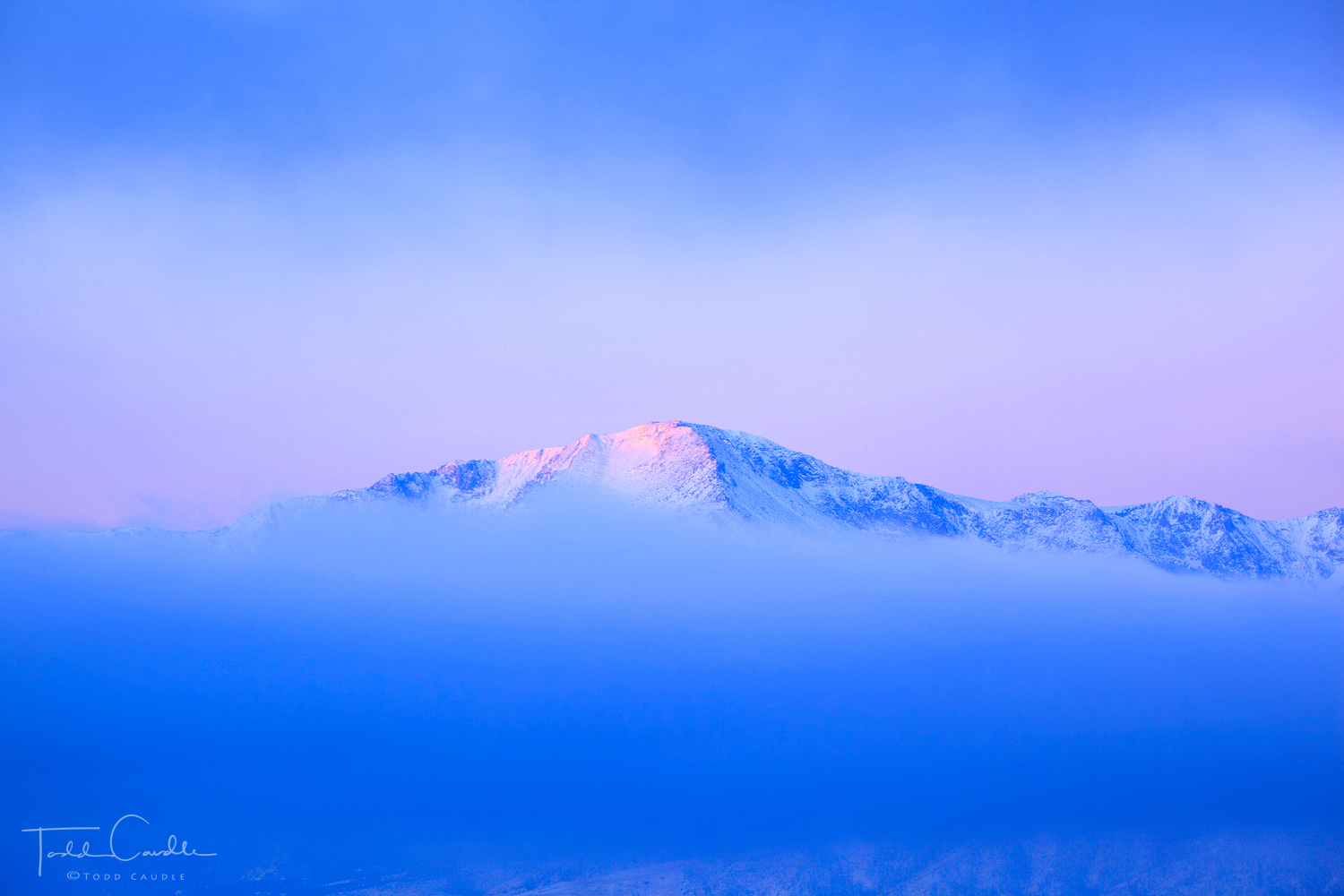 Pastel hues as the sun begins to rise over Pikes Peak.