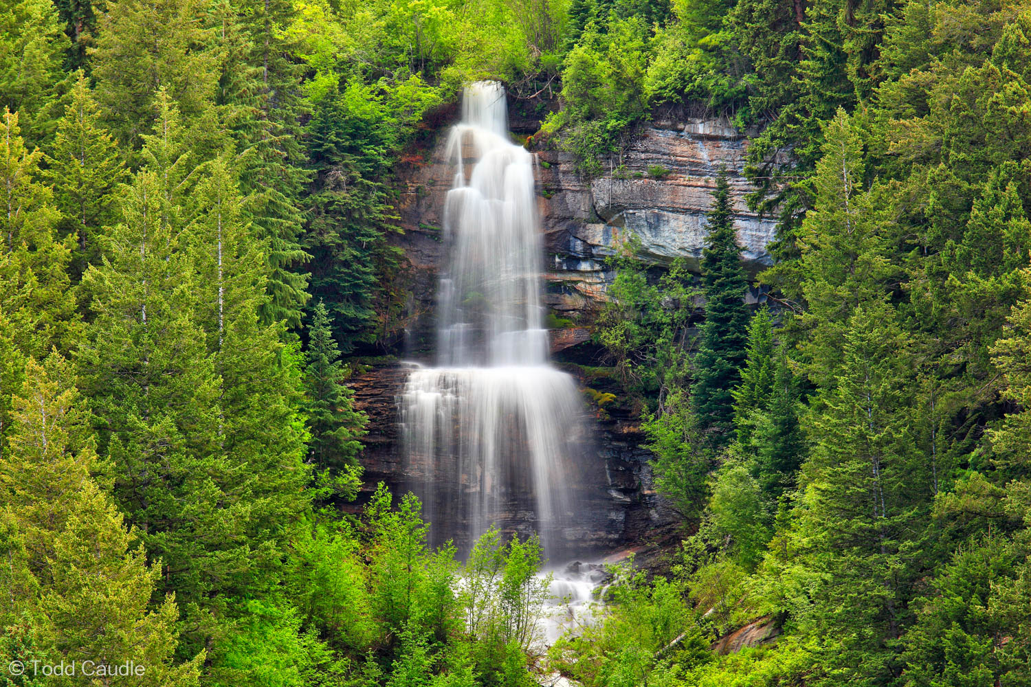 Spring runoff spills over Shadow Falls in Vail.