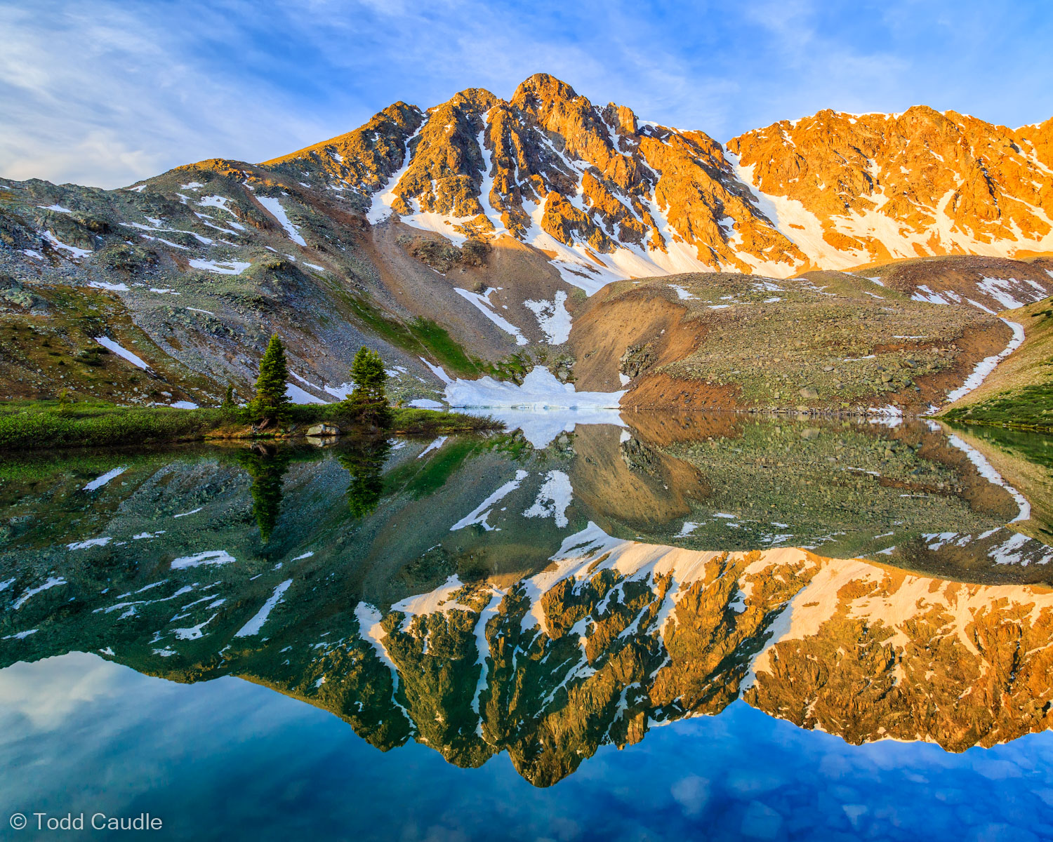 The stillness of sunrise provides the perfect reflecting pool for an unnamed peak at Anderson Lake, Elk Mountains.