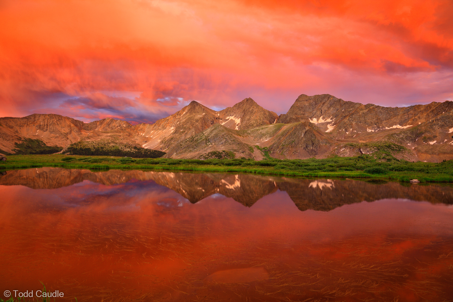 One of the most extraordinary sunsets this photographer has ever seen fills the skies over the Three Apostles with crimson clouds...