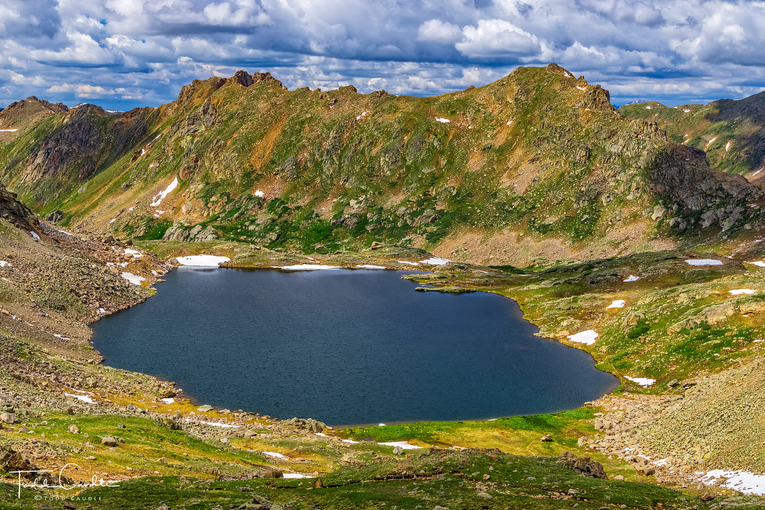 An unnamed 12,800-foot pass between Independence Lake and Lost Man Lake provides this viewpoint of the latter body of water in...