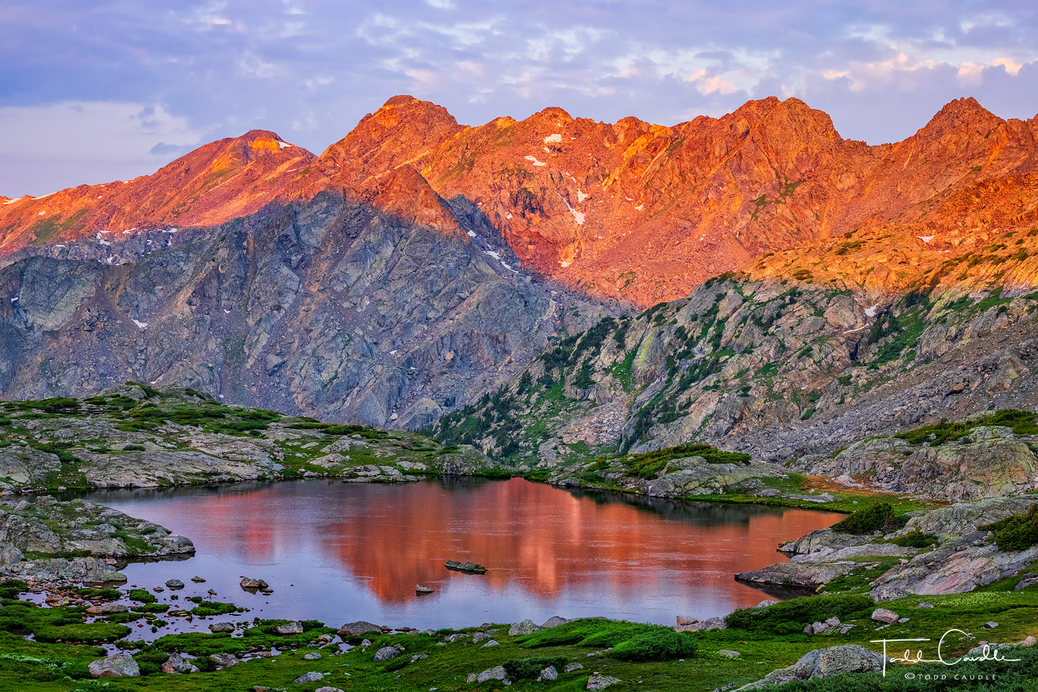 Dramatic, serrated Holy Cross Ridge catches alpenglow light at sunrise deep in the heart of Holy Cross Wilderness. This pristine...