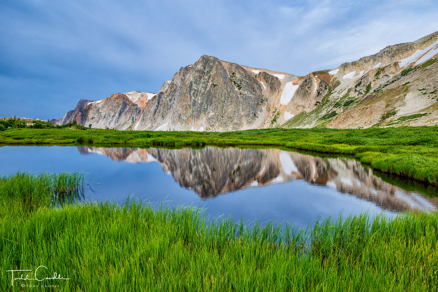 Old Main (11,755') reflects in a perfectly mirrored tarn at 11,000 feet in the Snowy Range.
